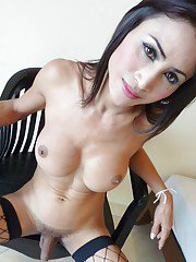 Busty Asian shemale Fon shows off nice tits and shaved tranny cock