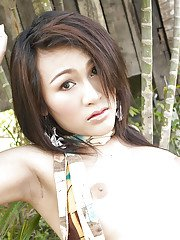 Gorgeous Thai ladyboy Gelly and her uncut shecock posing solo outdoors