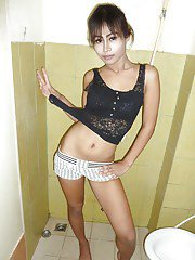 Cute young Asian tranny Bee revealing her big dick and spreading her ass