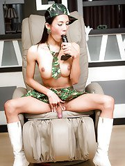 Big tit Asian ladyboy Ja showing off her guns and boobs in soldier uniform