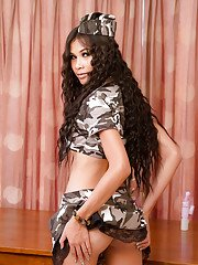 Gorgeous Thai ladyboy Far fingering her tight pussy in a soldier costume