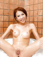 Redhead Asian tranny bombshell Ae playing with her pussy in the bathroom