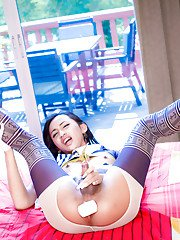 Gorgeous young Thai ladyboy Natty posing solo in cute sailor uniform