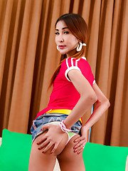 Petite Asian ladyboy Sprite bending over and toying her tight bum