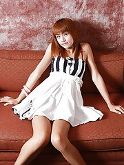 Redhead Asian ladyboy Sandy posing and spreading her legs in lingerie