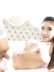Horny Asian shemale Mos stroking her shaft and toying her tight asshole