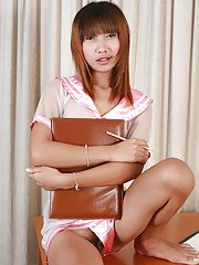 Tiny tit Asian shemale Pat 3 posing on a table with a hard dick