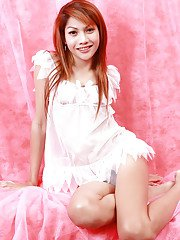 Skinny redhead Thai ladyboy Tong spreading her legs and jerking off