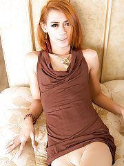 Redhead tall Asian Ladyboy Ally is showing her cute small dick