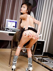 Perfect Thai shemale model Minnie masturbates in her new boots at work