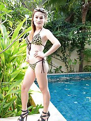 Busty blonde Thai ladyboy Meiji rubbing her pussy and posing outdoors