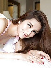 Kinky Thai ladyboy Minow does her best jerking off in the bedroom