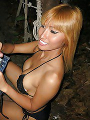 Gorgeous big tit Asian shemale showing off her tranny pack outdoors