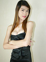 Skinny Asian shemale Toy posing in a dress and showing her hairy cock