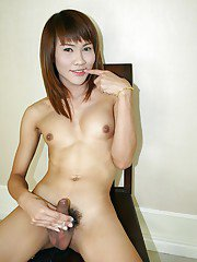 Small-tit skinny Asian shemale June spreading legs so wide!
