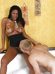 Older ebony transsexual Andreia Oliveira bum fucks a much younger man
