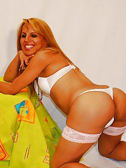 Latina shemale Jaqueline strips down to her stockings and heels