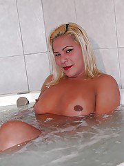 Hung tranny Shirley shows off her big cock and huge ass in the bath