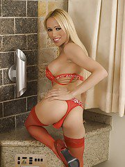 Gorgeous blonde transsexual Shakira Maya posing solo in sexy red nylons