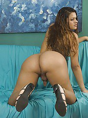 Latina shemale Cyara Stone exposing her big butt and jerking off