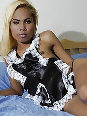 Skinny Thai shemale in sexy maids uniform bares her flat chest