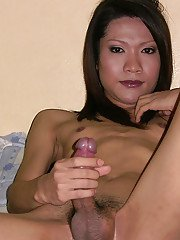 Flat chested Asian Ladyboy Creamy jerking thick cock and fingering asshole