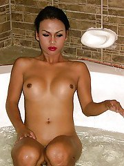 Sexy Asian Ladyboy Amy takes her small shecock and nice tranny tits to bath
