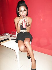 Dark and elegant Thai shemale enjoys her leather sofa quite well