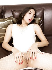 White tranny Pangurum on a sofa in white is stockings horny as hell