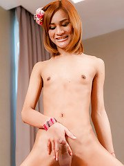 Hot Thai ladyboy Benty fingers herself doggy style on the bed
