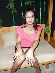 Young Thai shemale strips off skirt bra and panties after upskirt flash