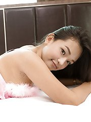 Gorgeous teen ladyboy Bai Thong posing solo in all white outfit