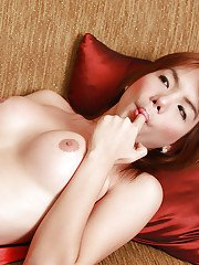 Asian ladyboy Zaza pull her shecock out of panties for masturbation