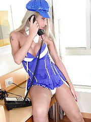 Blonde Latina tranny Bia Spencer striking hot fully clothed poses