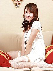 Innocent looking ladyboy Pang 3 modeling solo and jerking cock