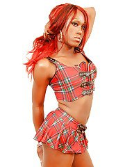 Redheaded ebony tranny Foxy removes skirt to reveal big shedick