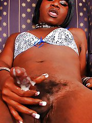 Collared ebony tranny Chanel squeezing cumshot from black shecock