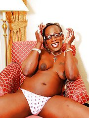 Nerdy ebony tranny Cookie baring small boobs before masturbating cock