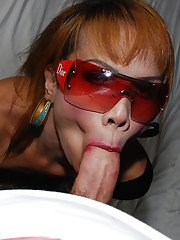 Glasses adorned Asian tranny on male POV blowjob action with Mona