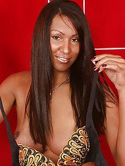 Ebony shemale Cristina Close modeling solo while revealing big tits