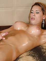 Latina tranny Dartilly Richilliely oils juggs and cock before masturbating