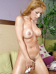 Busty blonde solo tranny Patricia Bismark pouring ketchup on tits and cock