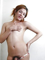 Redheaded Asian shemale Jhella letting big hairy dick loose from panties