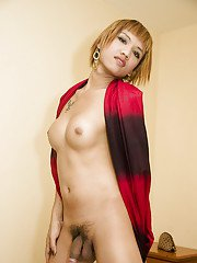 Short haired Asian ladyboy Yoyo showing off big tits and shaved shecock