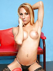 Blonde shemale Mylena Bysmark modeling solo in stockings with big cock out