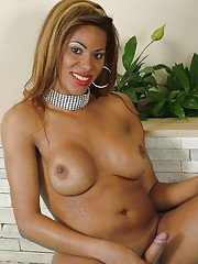 Nerdy ebony tranny Ester and her big tits pose topless in pool