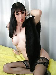 Brunette solo tranny Alessandra Ferraz flaunting big tits in stockings