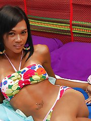 Skinny teen ladyboy Mint releasing big tits from bikini top and speading