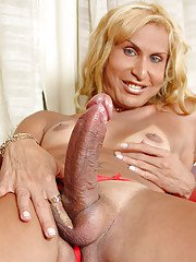 Mature blonde tranny Paty Bionda letting large cock free from panties