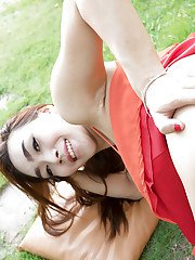 Pretty Asian shemale Emmy 2 baring nice big teen tits and ass outdoors